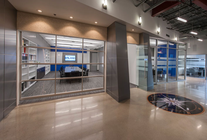 Maugel's Design for Erland Construction Featured in NE Real Estate Journal